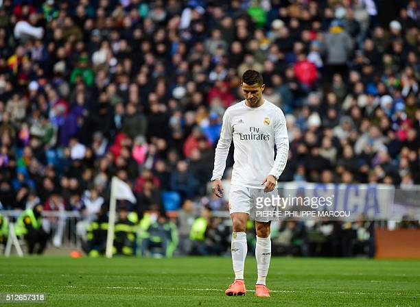 Real Madrid's Portuguese forward Cristiano Ronaldo looks downwards during the Spanish league football match Real Madrid CF vs Club Atletico de Madrid...