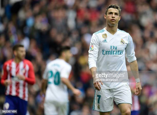 Real Madrid's Portuguese forward Cristiano Ronaldo looks on during the Spanish league football match between Real Madrid CF and Club Atletico de...