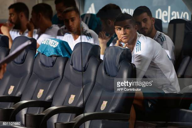 Real Madrid's Portuguese forward Cristiano Ronaldo looks on from the bench before the Spanish Supercup first leg football match FC Barcelona vs Real...