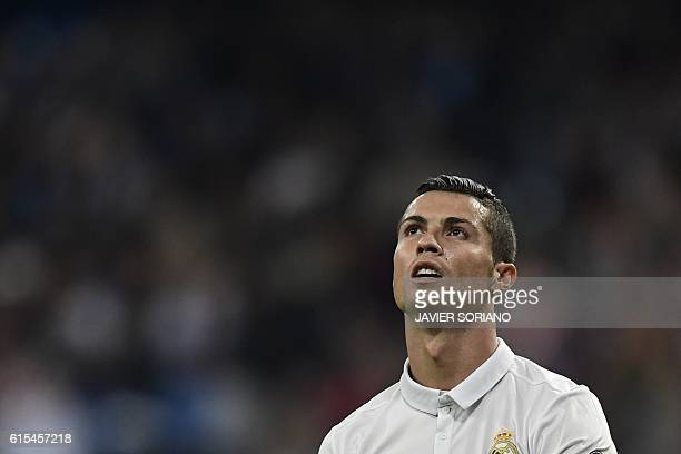 TOPSHOT Real Madrid's Portuguese forward Cristiano Ronaldo looks skywards during the UEFA Champions League football match Real Madrid CF vs Legia...