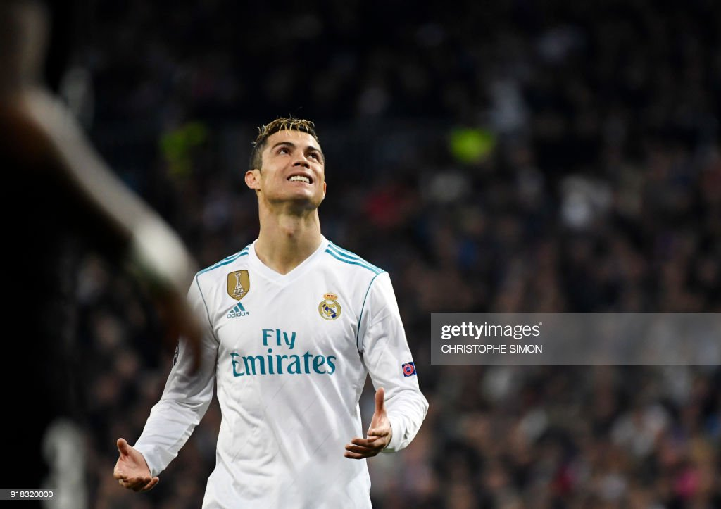TOPSHOT - Real Madrid's Portuguese forward Cristiano Ronaldo looks upwards during the UEFA Champions League round of sixteen first leg football match Real Madrid CF against Paris Saint-Germain (PSG) at the Santiago Bernabeu stadium in Madrid on February 14, 2018. /