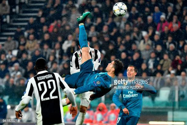 Real Madrid's Portuguese forward Cristiano Ronaldo overhead kicks and scores during the UEFA Champions League quarter-final first leg football match...