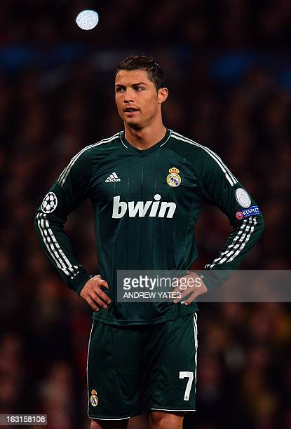 Real Madrid's Portuguese forward Cristiano Ronaldo pauses during the UEFA Champions League round of 16 second leg football match between Manchester...