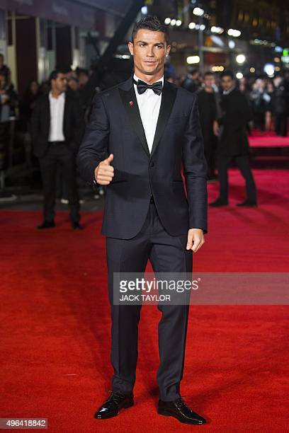 Real Madrid's Portuguese forward Cristiano Ronaldo poses on arrival for the world premiere of the film Ronaldo in central London on November 9 2015...