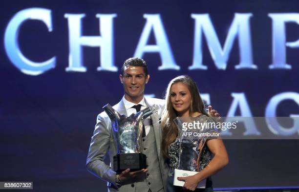 Real Madrid's Portuguese forward Cristiano Ronaldo poses the trophy after he was awarded the title of UEFA 2016/17 Best football Player while...