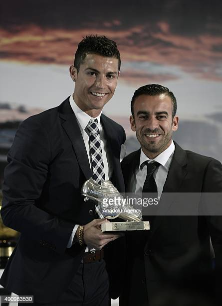 Real Madrid's Portuguese forward Cristiano Ronaldo poses with his manager Jorge Mendes during a tribute ceremony in his honour for becoming the...