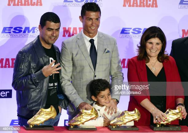 Real Madrid's Portuguese forward Cristiano Ronaldo poses with his mother Dolores Aveiro his son Cristiano Ronaldo Jr and his brother Hugo after...