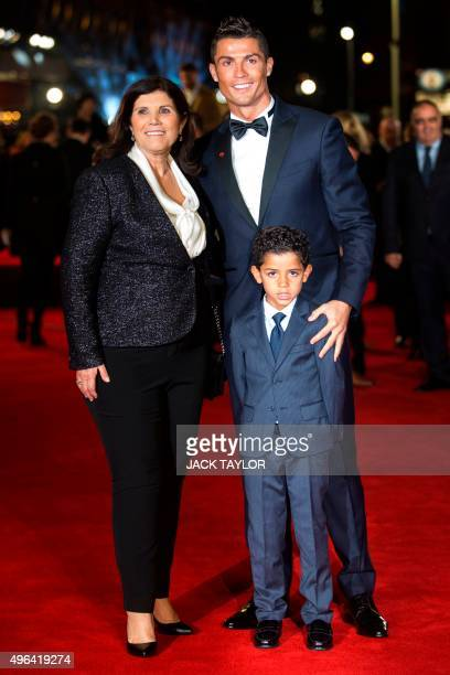 Real Madrid's Portuguese forward Cristiano Ronaldo poses with his mother Maria Dolores dos Santos Aveiro and son Cristiano Ronaldo Jr on arrival for...