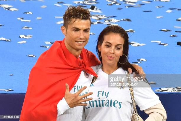 Real Madrid's Portuguese forward Cristiano Ronaldo poses with his girlfriend Georgina Rodriguez after his team won the UEFA Champions League final...