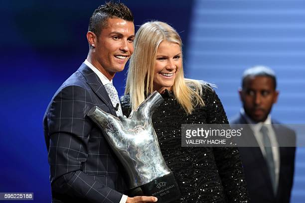 Real Madrid's Portuguese forward Cristiano Ronaldo poses with Lyon's Norwegian forward Ada Hegerberg as he holds his trophy of Best Men's player in...