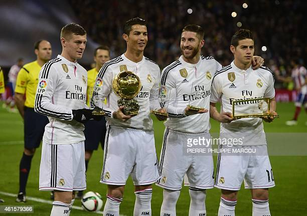 Real Madrid's Portuguese forward Cristiano Ronaldo poses with the 2014 FIFA Ballon d'Or award for player of the year past Real Madrid's German...