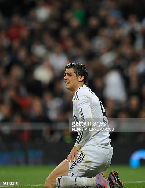 Real Madrid's Portuguese forward Cristiano Ronaldo postures after missing a shot against Atletico Madrid during their Spanish League football match...