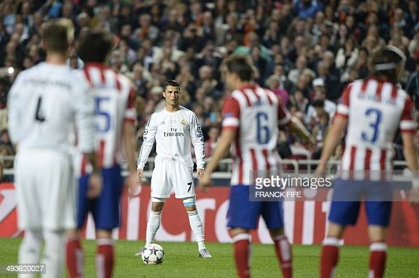 Real Madrid's Portuguese forward Cristiano Ronaldo prepares to executes a free kick during the UEFA Champions League Final Real Madrid vs Atletico de...