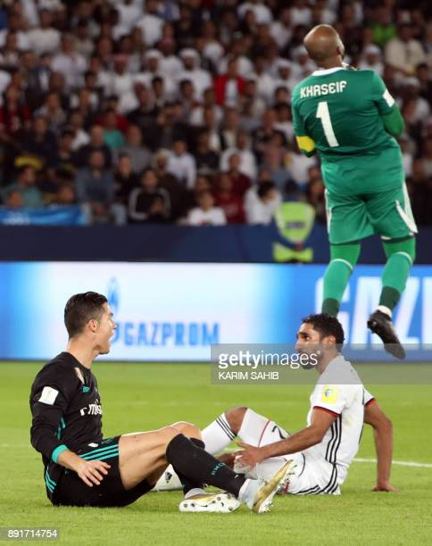 Real Madrid's Portuguese forward Cristiano Ronaldo reacts after a challenge from alJazira's Emirati defender Salem Rashid during the FIFA Club World...