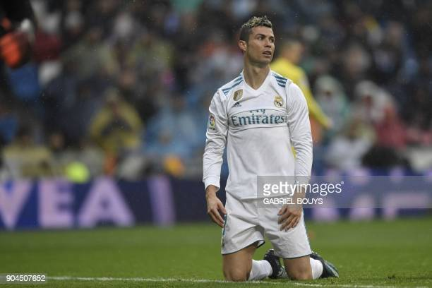 Real Madrid's Portuguese forward Cristiano Ronaldo reacts after missing a goal opportunity during the Spanish league football match between Real...