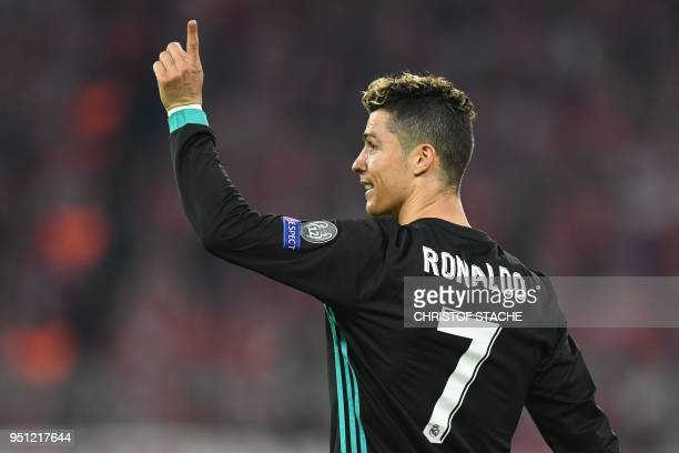 Real Madrid's Portuguese forward Cristiano Ronaldo reacts after scoring a goal that was disallowed during the UEFA Champions League semifinal...