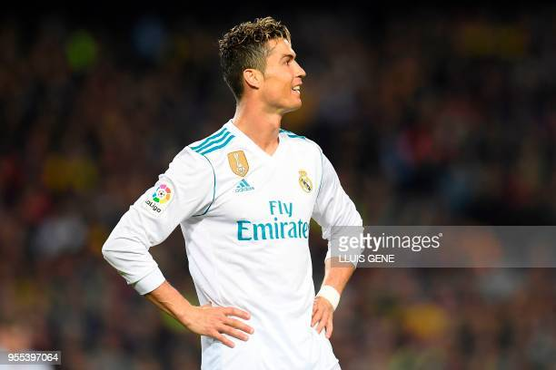Real Madrid's Portuguese forward Cristiano Ronaldo reacts after missing a goal opportunity during the Spanish league football match between FC...