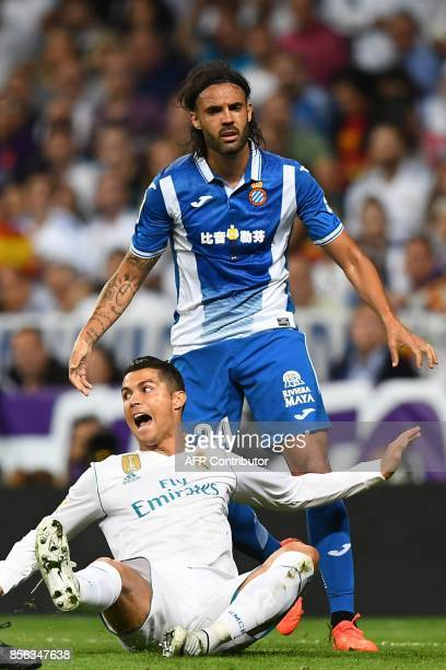 Real Madrid's Portuguese forward Cristiano Ronaldo reacts after being fouled by Espanyol's Spanish defender Sergio Sanchez during the Spanish league...