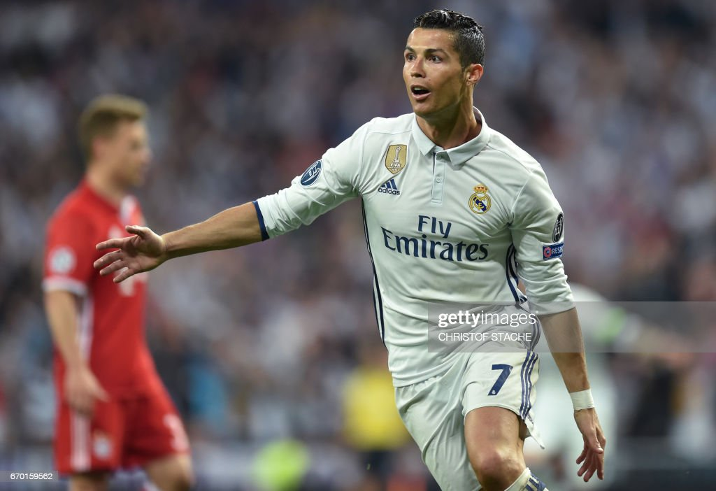 Real Madrid's Portuguese forward Cristiano Ronaldo reacts after his second goal for Madrid during the UEFA Champions League quarterfinal second leg football match Real Madrid vs FC Bayern Munich at the Santiago Bernabeu stadium in Madrid, Spain, on April 18, 2017. / AFP PHOTO / Christof STACHE