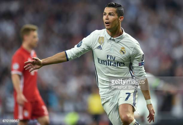 Real Madrid's Portuguese forward Cristiano Ronaldo reacts after his second goal for Madrid during the UEFA Champions League quarterfinal second leg...