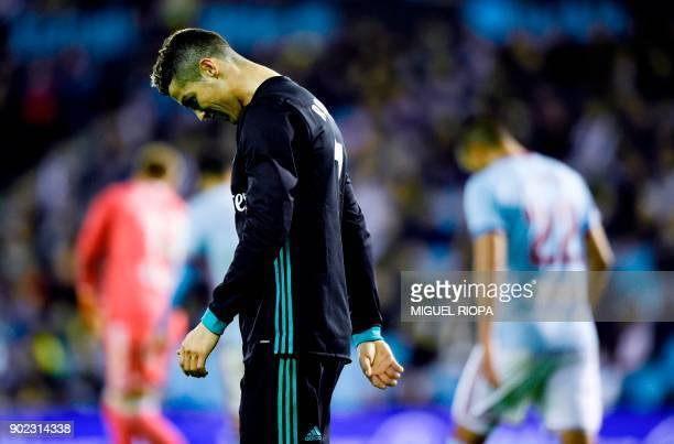 Real Madrid's Portuguese forward Cristiano Ronaldo reacts at the end of the Spanish league football match Celta de Vigo vs Real Madrid at the...