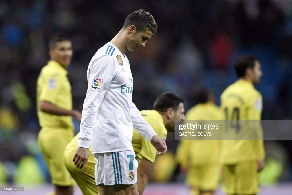Real Madrid's Portuguese forward Cristiano Ronaldo reacts at the end of the Spanish league football match between Real Madrid and Villarreal at the Santiago Bernabeu Stadium in Madrid on January 13, 2018. /