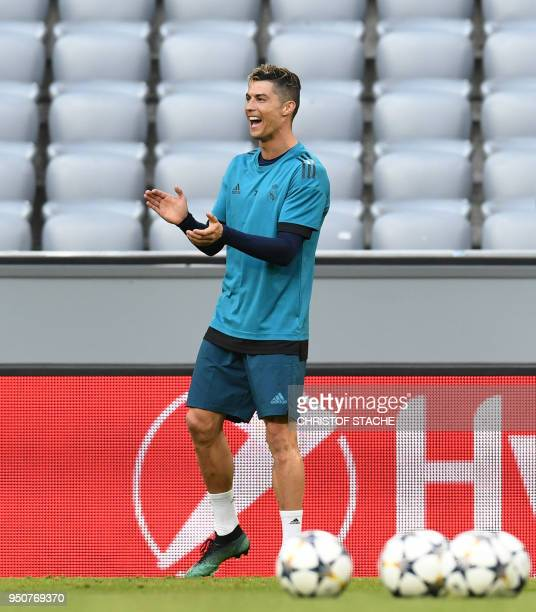 Real Madrid's Portuguese forward Cristiano Ronaldo reacts during a training session on the eve of the UEFA Champions League semifinal firstleg...
