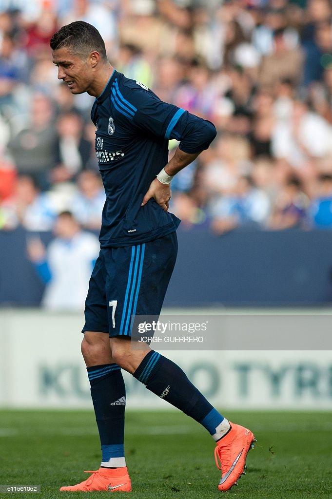 TOPSHOT - Real Madrid's Portuguese forward Cristiano Ronaldo reacts during the Spanish league football match Malaga CF vs Real Madrid CF at La Rosaleda stadium in Malaga on February 21, 2016. / AFP / JORGE