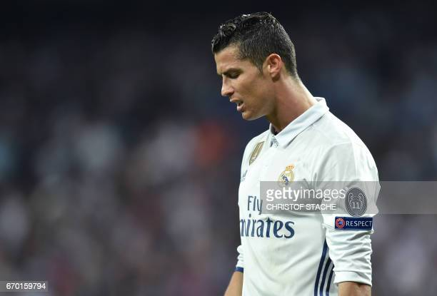 Real Madrid's Portuguese forward Cristiano Ronaldo reacts during the UEFA Champions League quarterfinal second leg football match Real Madrid vs FC...