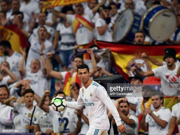 Real Madrid's Portuguese forward Cristiano Ronaldo reacts during the Spanish league football match Real Madrid CF vs RCD Espanyol at the Santiago...