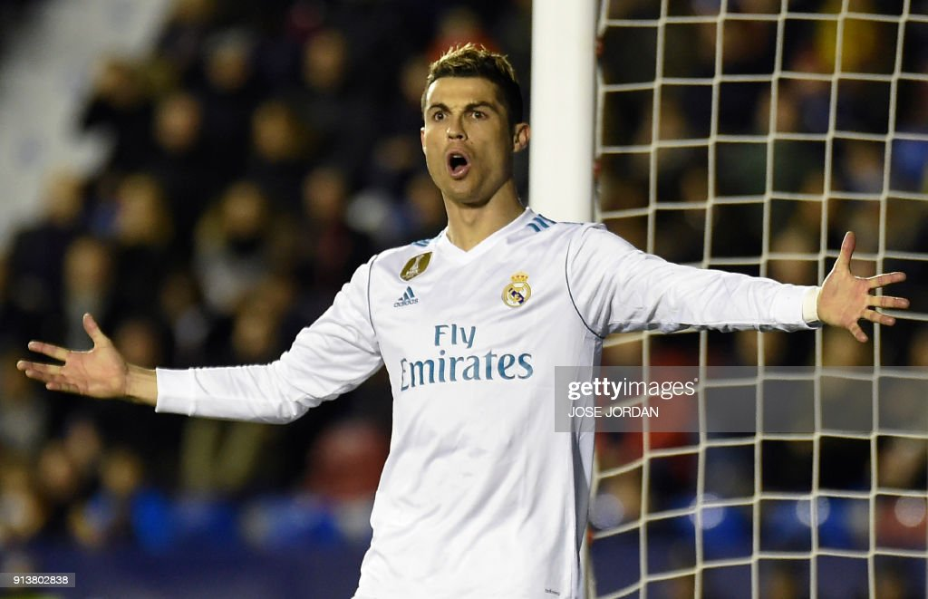 TOPSHOT - Real Madrid's Portuguese forward Cristiano Ronaldo reacts during the Spanish league football match between Levante UD and Real Madrid CF at the Ciutat de Valencia stadium in Valencia on February 03, 2018. /