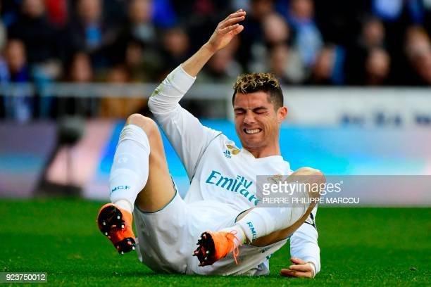 TOPSHOT Real Madrid's Portuguese forward Cristiano Ronaldo reacts during the Spanish league football match between Real Madrid CF and Deportivo...