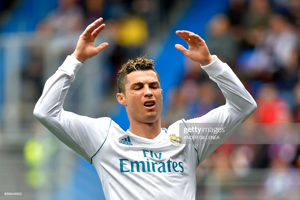 TOPSHOT - Real Madrid's Portuguese forward Cristiano Ronaldo reacts during the Spanish league football match between Eibar and Real Madrid at the Ipurua stadium in Eibar on March 10, 2018. /