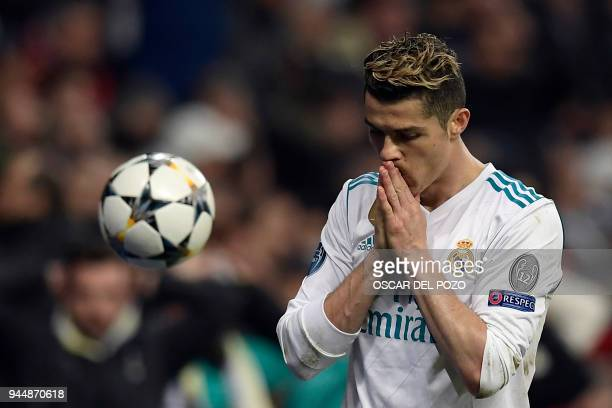 Real Madrid's Portuguese forward Cristiano Ronaldo reacts during the UEFA Champions League quarterfinal second leg football match between Real Madrid...