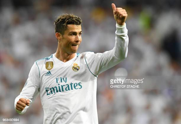 Real Madrid's Portuguese forward Cristiano Ronaldo reacts during the UEFA Champions League semifinal secondleg football match Real Madrid CF vs FC...
