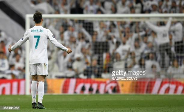 TOPSHOT Real Madrid's Portuguese forward Cristiano Ronaldo reacts during the UEFA Champions League semifinal secondleg football match Real Madrid CF...