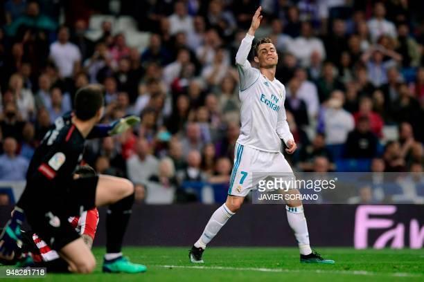 Real Madrid's Portuguese forward Cristiano Ronaldo reacts in front of Athletic Bilbao's Spanish goalkeeper Kepa Arrizabalaga Revuelta during the...