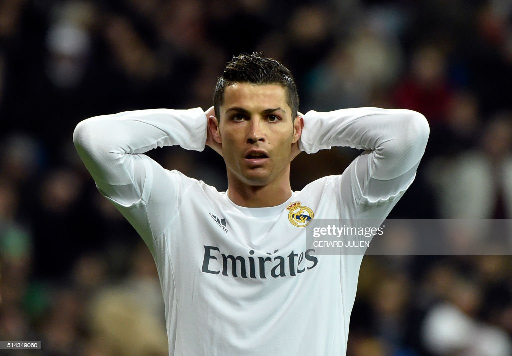 Real Madrid's Portuguese forward Cristiano Ronaldo reacts to missing a goal opportunity during the UEFA Champions League round of 16, second leg football match Real Madrid FC vs AS Roma at the Santiago Bernabeu stadium in Madrid on March 8, 2016. /