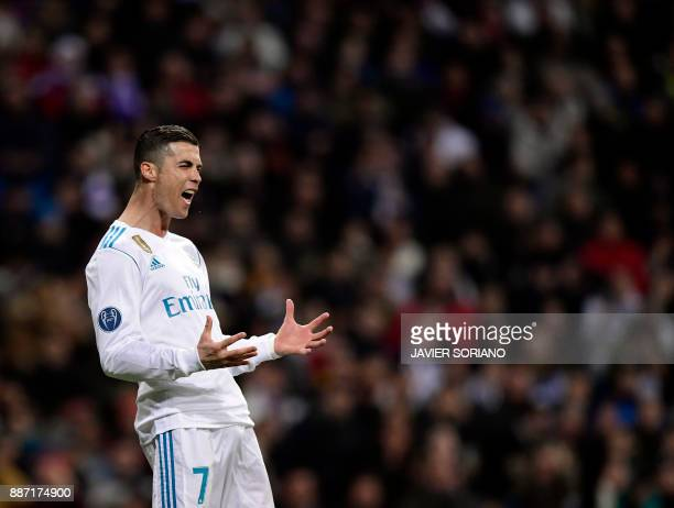 Real Madrid's Portuguese forward Cristiano Ronaldo reacts to missing a goal during the UEFA Champions League group H football match Real Madrid CF vs...