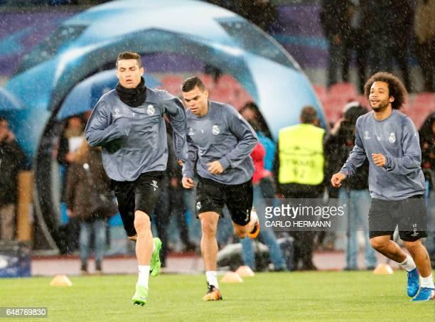 CORRECTION Real Madrid's Portuguese forward Cristiano Ronaldo Real Madrid's Brazilian defender Marcelo and Real Madrid's Portuguese defender Pepe...
