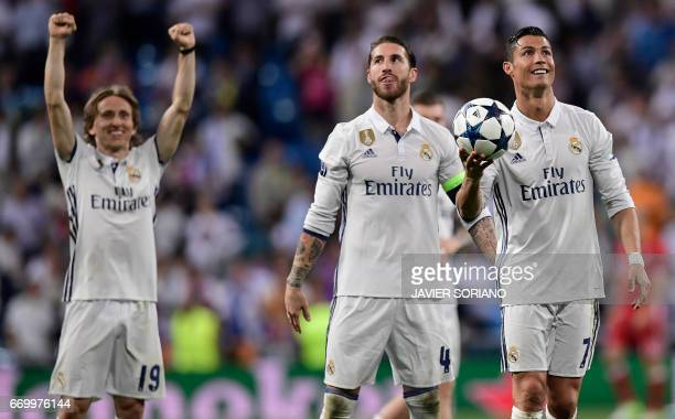 Real Madrid's Portuguese forward Cristiano Ronaldo Real Madrid's defender Sergio Ramos and Real Madrid's Croatian midfielder Luka Modric celebrate at...