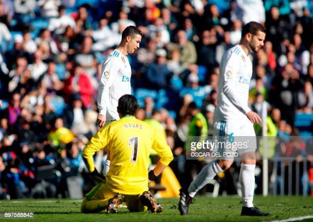 Real Madrid's Portuguese forward Cristiano Ronaldo Real Madrid's Costa Rican goalkeeper Keylor Navas and Real Madrid's Spanish defender Nacho...