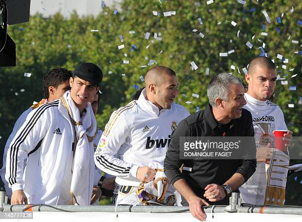 Real Madrid's Portuguese forward Cristiano Ronaldo Real Madrid's French forward Karim Benzema Real Madrid's Portuguese coach Jose Mourinho and Real...