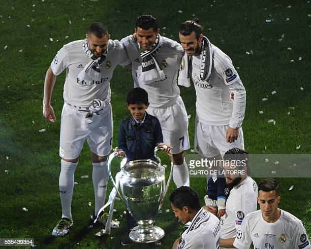 Real Madrid's Portuguese forward Cristiano Ronaldo Real Madrid's French forward Karim Benzema and Real Madrid's Welsh forward Gareth Bale pose with...