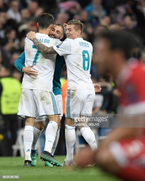 Real Madrid's Portuguese forward Cristiano Ronaldo Real Madrid's French forward Karim Benzema and Real Madrid's German midfielder Toni Kroos...