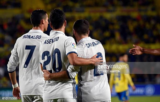 Real Madrid's Portuguese forward Cristiano Ronaldo Real Madrid's forward Marco Asensio Willemsen and Real Madrid's defender Daniel Carvajal Ramos...