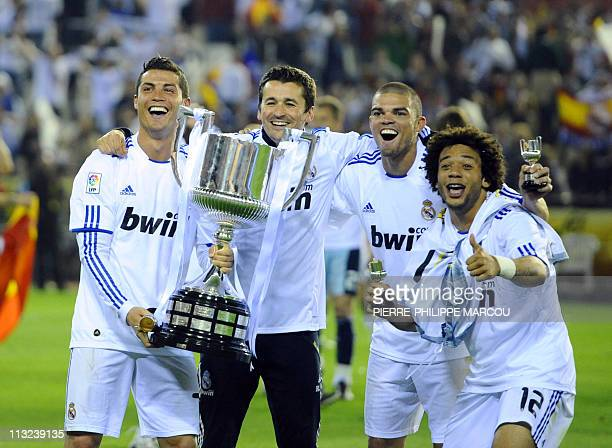 Real Madrid's Portuguese forward Cristiano Ronaldo Real Madrid's Portuguese defender Pepe and Real Madrid's Brazilian defender Marcelo celebrate with...