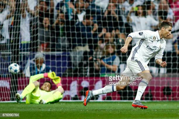 Real Madrid's Portuguese forward Cristiano Ronaldo runs after scoring a goal during the UEFA Champions League semifinal first leg football match Real...