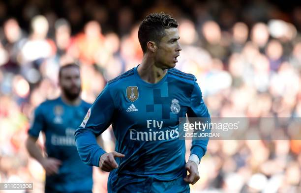Real Madrid's Portuguese forward Cristiano Ronaldo runs after shooting a penalty kick to score a goal during the Spanish league football match...