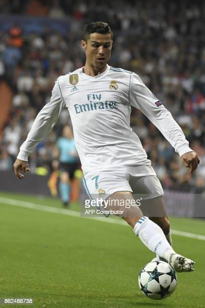 Real Madrid's Portuguese forward Cristiano Ronaldo runs with the ball during the UEFA Champions League group H football match Real Madrid CF vs...